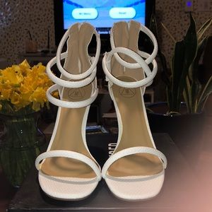 Four strap heel
